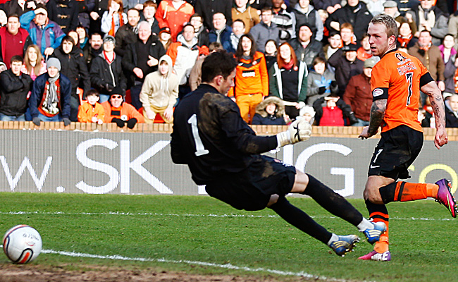 Johnny Russell (right) scored after just 16 seconds for Dundee United, and again in 79th minute.
