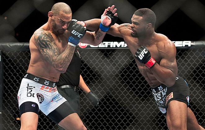 Tyron Woodley connects with a right while defeating Jay Hieron during a UFC 156 undercard match.