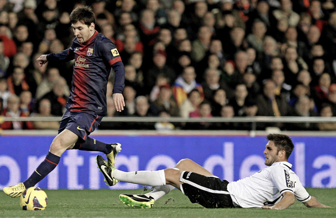 Lionel Messi scored a goal to help salvage a tie against a pesky Valencia side.