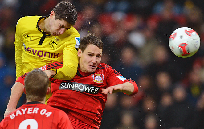 Dortmund striker Robert Lewandowski (left) battles Leverkusen's Philipp Wollscheid on Sunday.