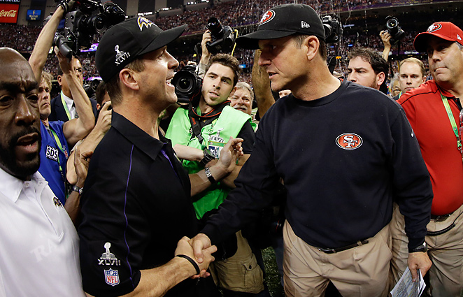 John Harbaugh (left) said shaking hands with his brother, Jim, after the game was very difficult.