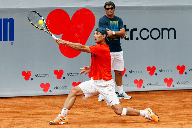 Rafael Nadal, practicing under the watchful eye of coach and uncle Toni Nadal, hasn't played since June.