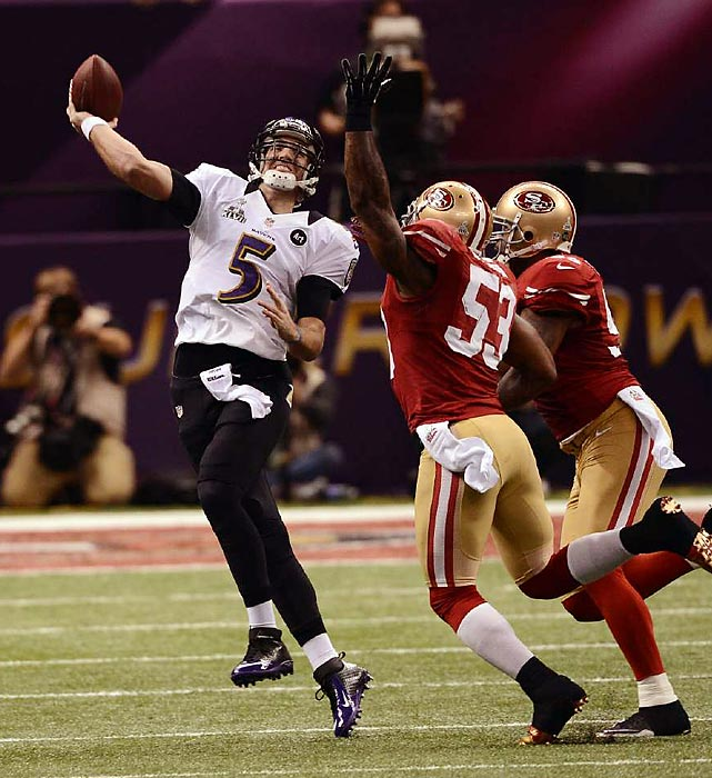 Joe Flacco throws on the run as the San Francisco 49ers defense pursues him. The Baltimore Ravens quarterback had a stellar game, completing 22 of 33 passes for 287 yards with three touchdowns and no interceptions. He tied Joe Montana as the only quarterbacks to throw 11 touchdowns with no interceptions in a postseason run.