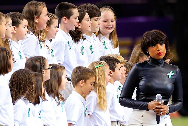 "Singer Jennifer Hudson performs ""America the Beautiful"" with the Sandy Hook Elementary School chorus before the start of Super Bowl XLVII."