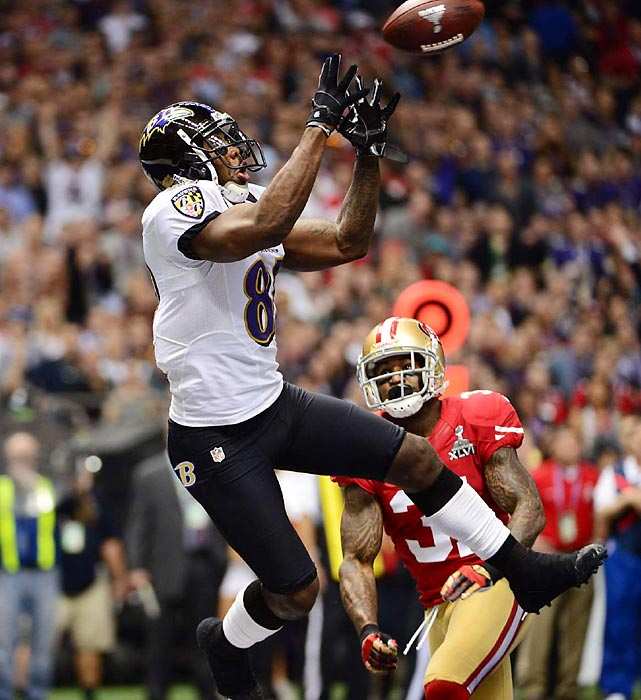 Wide receiver Anquan Boldin reaches out for a 13-yard touchdown completion from Joe Flacco in the first quarter of Super Bowl XLVII. Boldin's catch opened the scoring as the Baltimore Ravens built a 28-6 lead by the first play of the second half. Boldin finished the game with six catches for 104 yards.