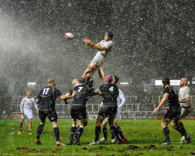 Graham Kitchener rises through the snow to win the lineout during a friendly between England Saxons and Scotland A in Newcastle upon Tyne, England. Scotland earned the victory 13-9, sparked by a first-minute try from Duncan Taylor.