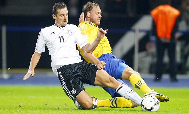 MIroslav Klose (left) is the second all-time leading scorer in World Cup history.