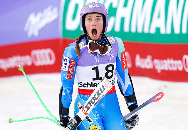 Super-G winner Tina Maze reacts as she watches Lindsey Vonn's crash unfold immediately after her run.