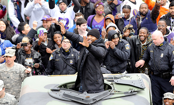Ray Lewis waves to fans as the Ravens' Super Bowl parade marches through Baltimore.