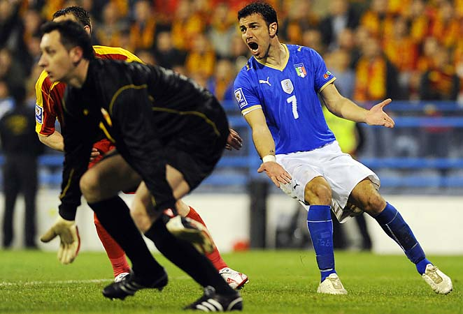 Vukasin Poleksic (left) plays in a 2010 FIFA World Cup qualifying match against Italy.