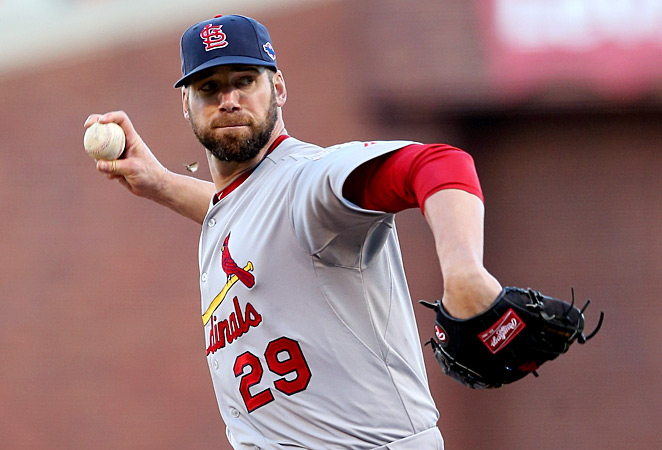 Chris Carpenter threw about 20 pitches to teammates Shane Robinson and Matt Adams on Monday.