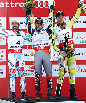 Ted Ligety celebrates his super-G world title on the podium, flanked by Gauthier De Tessieres of France (second) and Aksel Lund Svindal of Norway (third).