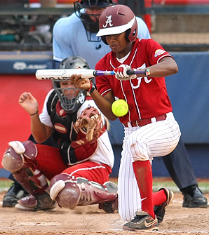 Alabama's Keima Davis lays down a bunt during the 2012 College World Series Championship.