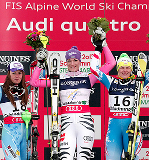 Maria Hoefl Riesch celebrates on the podium with Tina Maze and Nicole Hosp after winning the women's super-combined at the world championships.