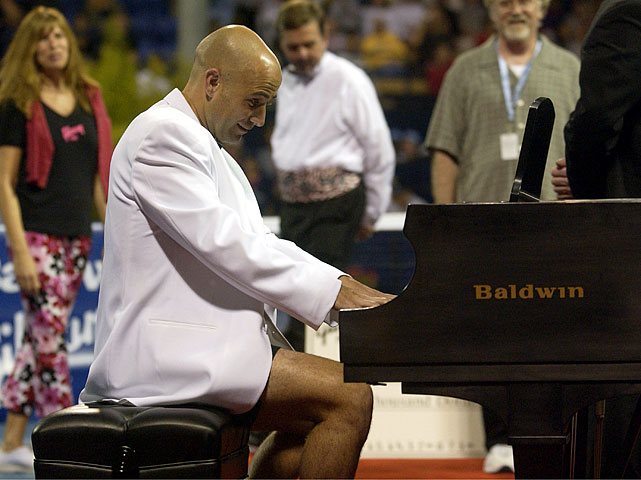 The tennis great plays the new Baldwin piano donated to his charity on July 22, 2002, in Los Angeles.