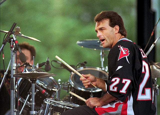 "The quarterback plays drums for the ""Flutie Brothers Band,"" performing at Lafayette Square in Buffalo on June 3, 1999."