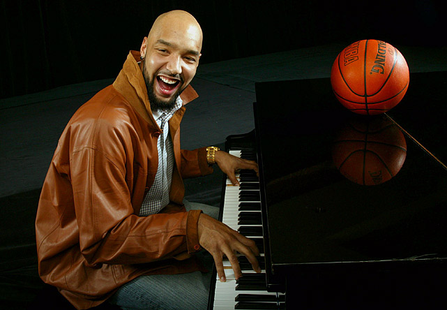 The NBA forward plays piano at the Four Seasons Hotel in Washington, DC, on Feb. 9, 2006