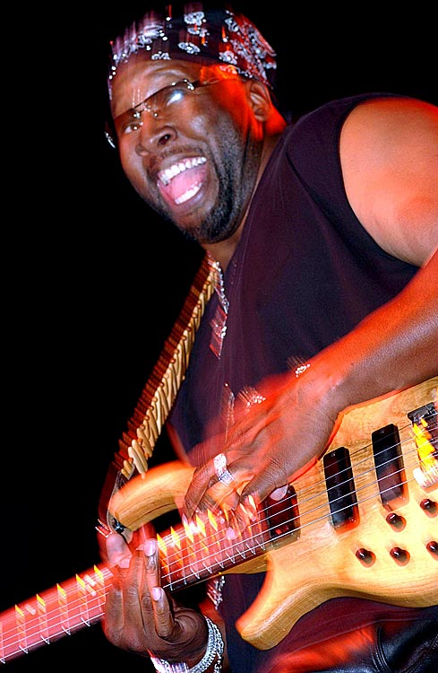 The retired NBA forward plays bass guitar during the All-Star NBA Jam Session at the Colorado Convention Center on Feb. 17, 2005 in Denver.