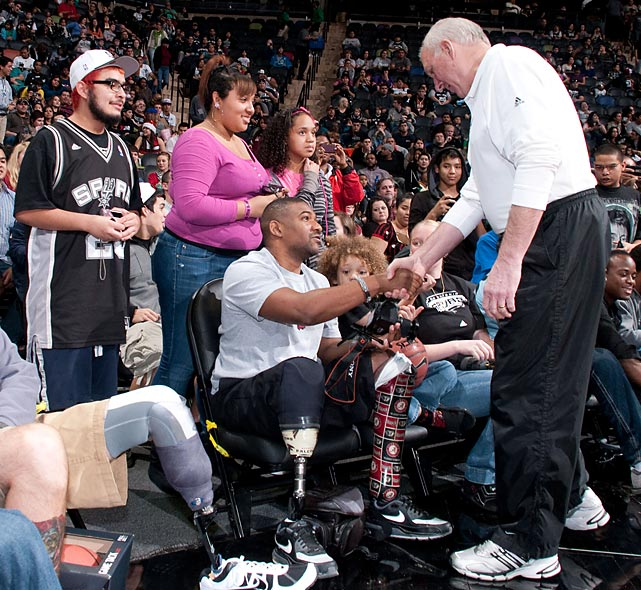 Spurs coach Gregg Popovich greets Wounded Warrior soldiers during San Antonio's open practice in 2011.