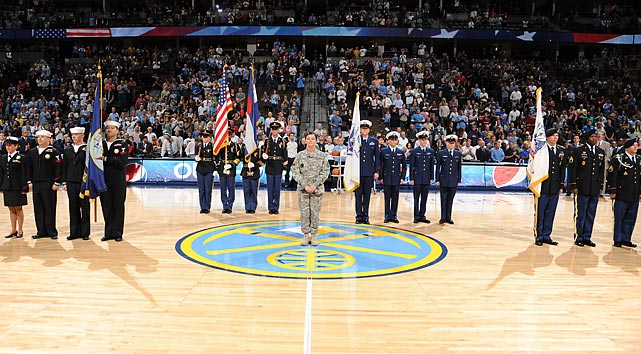 Members of the Armed Forces grace the court during a 2012 game between the Nuggets and the Clippers.
