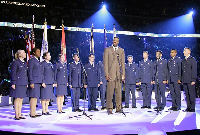 NBA legend and U.S. Navy veteran David Robinson introduces the Air Force Academy Choir before they perform the national anthem at the 2005 NBA All-Star Game.