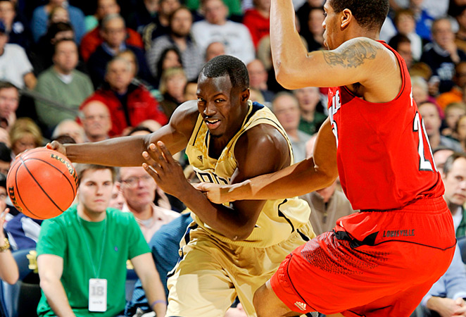 Jerian Grant (left) scored 12 points for Notre Dame in the game's final minute of regulation.