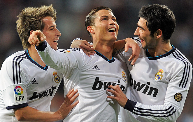 Cristiano Ronaldo (Center) scored three goals for Real Madrid during Saturday's 4-1 win over Sevilla.