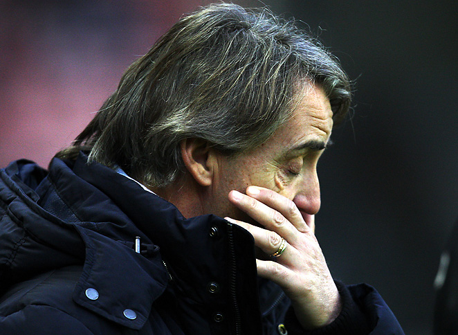 Frustrated Manchester City manager Roberto Mancini plans on altering his lineup on Sunday.