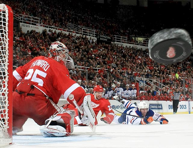 Jimmy Howard sends the puck careening towards the camera after making a blocker save in the Detroit Red Wings' game against the Edmonton Oilers on Feb. 9. Howard's 23 saves helped the Red Wings hang on for a 2-1 win.