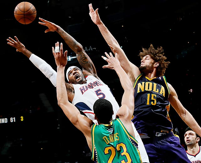 Atlanta Hawks forward Josh Smith loses the ball while getting defended by Anthony Davis and Robin Lopez of the New Orleans Hornets in a Feb. 8 game. Smith, who has been the subject of trade rumors, led the Hawks with 23 points, but New Orleans earned the victory 111-100.