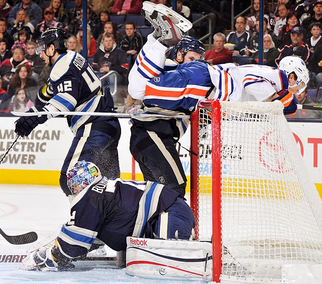 Edmonton Oilers left winger Taylor Hall ends up on top of the net after Columbus Blue Jackets goaltender Sergei Bobrovsky makes a save in the second period of the Feb. 10 game. Hall and the Oilers attack got the best of Bobrovsky with three goals on 14 shots -- the third goal was an empty netter -- in Edmonton's 3-1 victory.