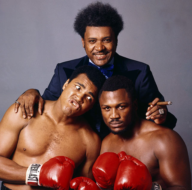"Leifer's memorable triple-portrait, shot during the build-up up to the third Ali-Frazier fight (dubbed the Thrilla in Manila), perfectly captured the dynamic of the sport, with the leering promoter looming over a playful Ali and a deadly-serious Frazier. Ali verbally abused Frazier during the buildup to the fight, telling the media that ""it will be a killa and a thrilla and a chilla when I get the gorilla in Manila."" Click here for Neil Leifer's fine art photography."