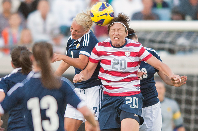 Abby Wambach (20) and Rhonda Jones (2) vie for the ball on Saturday as the U.S. toppled Scotland 4-1.