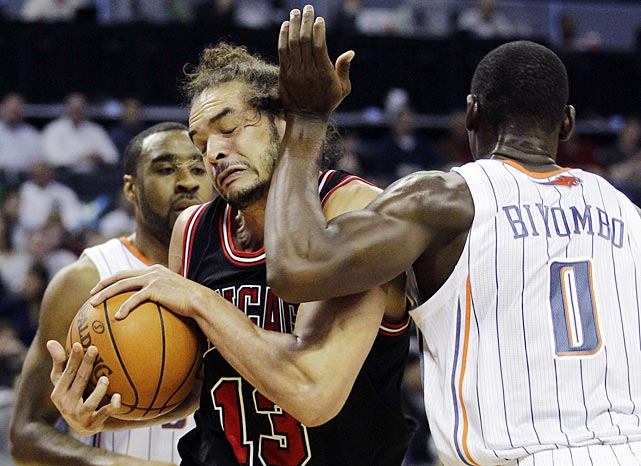 Charlotte's Bismack Biyombo gives Joakim Noah of the Bulls a hand in the face.