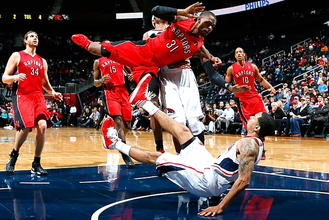 Terrence Ross of the Raptors draws what could have been a painful blocking foul from Devin Harris of Atlanta.