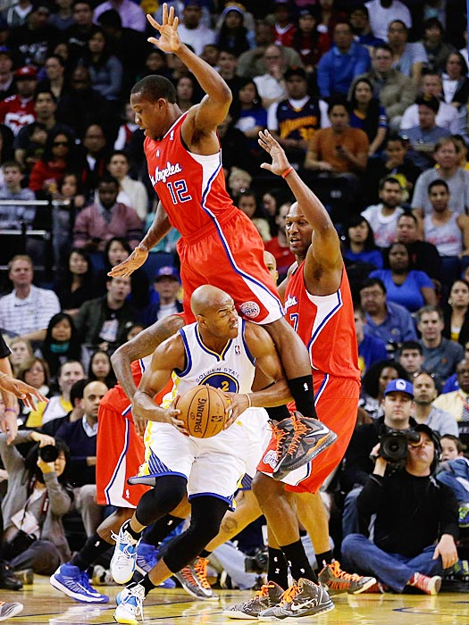 Eric Bledsoe of the Clippers towers over, and fouls, Jarrett Jack of the Golden State Warriors.