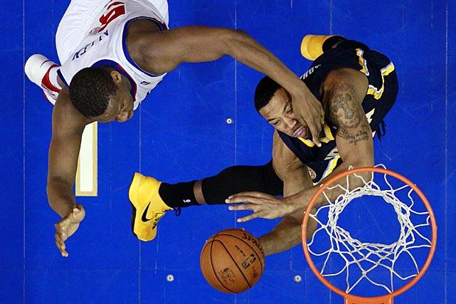 Philadelphia's heavy-handed Lavoy Allen fouls Indiana's Orlando Johnson.