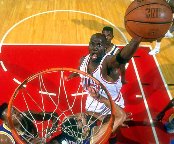 Jordan goes up for a one-handed slam in 1991. He averaged 31.5 points per game in the 1990-91 season, part of a seven-season stretch in which he scored more than 30 points per game.