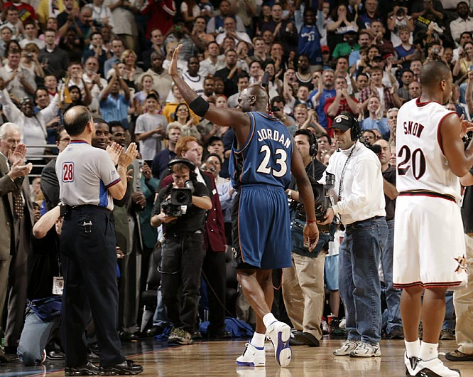 Jordan acknowledges the crowd's roaring applause during the final game of his NBA career on April 16, 2003. Despite playing on the road, Jordan received a three-minute standing ovation from the Philadelphia 76ers fans and players as he checked out of the game with 15 points, four rebounds and four assists.