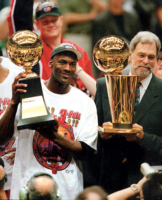 ordan holds the Finals MVP trophy as Phil Jackson raises the Larry O'Brien Trophy following the Bulls' victory over the Utah Jazz to win the 1998 NBA Finals. Jordan averaged 33.5 points per game in the six-game series to claim the last of his six Finals MVP Awards.