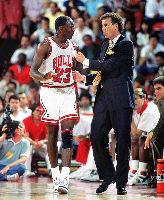 Bulls head coach Doug Collins advises Jordan in Game 5 of a 1988 Eastern Conference first-round playoff series against Cleveland. Jordan averaged 45.2 points per game as the Bulls advanced but lost to the Detroit Pistons in five games in the next round.