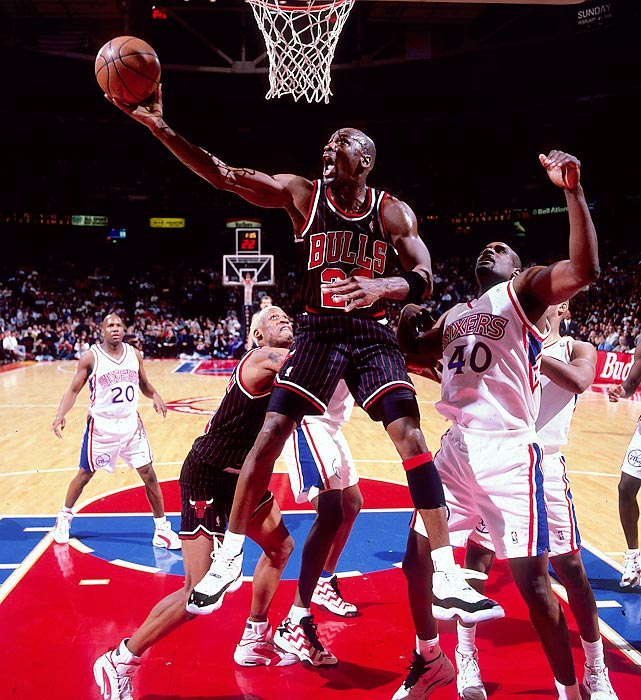 Jordan lays the ball in against the 76ers' LaSalle Thompson in a January 1996 game in Philadelphia. Jordan had nine games with 40 or more points during the 1995-96 season, including 48 points against the 76ers.