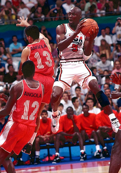 Jordan contorts in air to get a shot off against Angola in Team USA's 1992 Summer Olympic matchup in Barcelona. The Dream Team crushed every team it faced, never winning by fewer than 32 points and defeating Angola 116-48. Jordan averaged 14.9 points, second highest on the team.