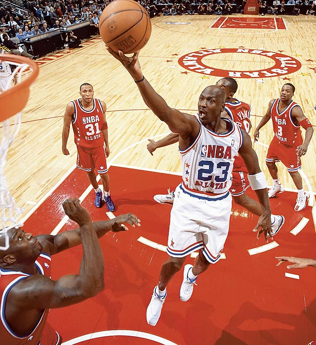 Jordan attacks the basket in his 14th and final All-Star Game in 2003. Jordan started the game when Vince Carter offered him his starting spot, and seemed poised to have the game winner with a baseline jumper with 4.8 seconds remaining in overtime. Instead, Jermaine O'Neal fouled Kobe Bryant to force a second overtime, and the West prevailed.