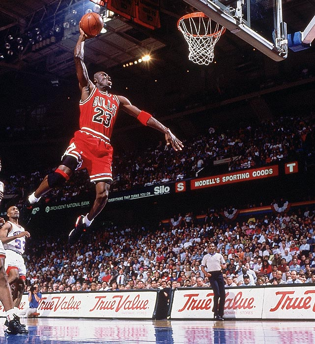 Jordan flies to the rim for a dunk against the Philadelphia 76ers.
