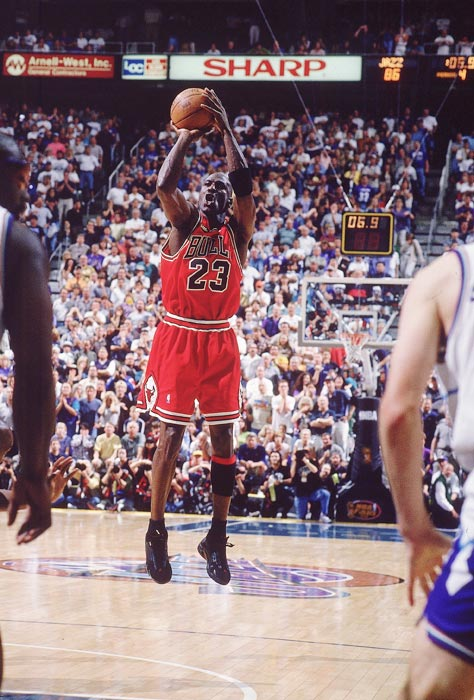 Jordan pulls up for his game-winning jumper to beat the Utah Jazz in Game 6 of the 1998 NBA Finals and clinch the championship. Jordan shook loose from defender Bryon Russell to nail the shot, his final in a Bulls' uniform.