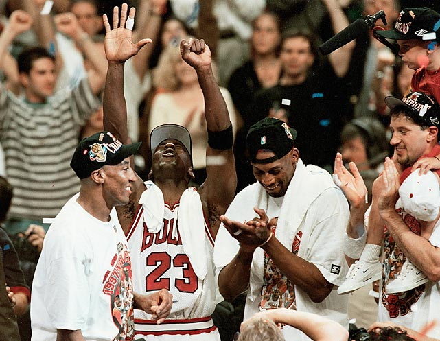 Jordan, Scottie Pippen and Dennis Rodman soak in the cheers at the United Center. The trio won three NBA titles together.