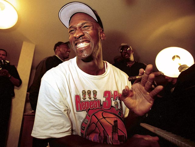 Jordan is all smiles, playing piano and smoking a cigar after winning his sixth national championship in 1998. The title finished off the second three-peat of championships of Jordan's career.