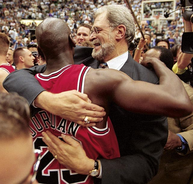 Jordan hugs Phil Jackson after winning the 1998 NBA Finals over the Utah Jazz. The championship victory was the last time either would represent the Chicago Bulls as Jordan retired for a second time after the season and Jackson took a year off from coaching before taking over the Los Angeles Lakers.