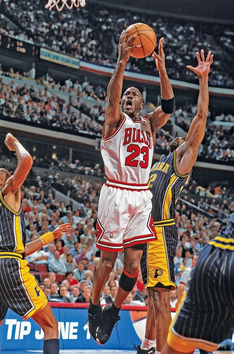 Jordan splits a double team to get a shot off against the Indiana Pacers in Game 2 of the 1998 Eastern Conference Finals. Jordan dominated the Pacers to will the Bulls to a victory, scoring 41 points with five assists, four rebounds and four steals. Chicago won the series in seven games.